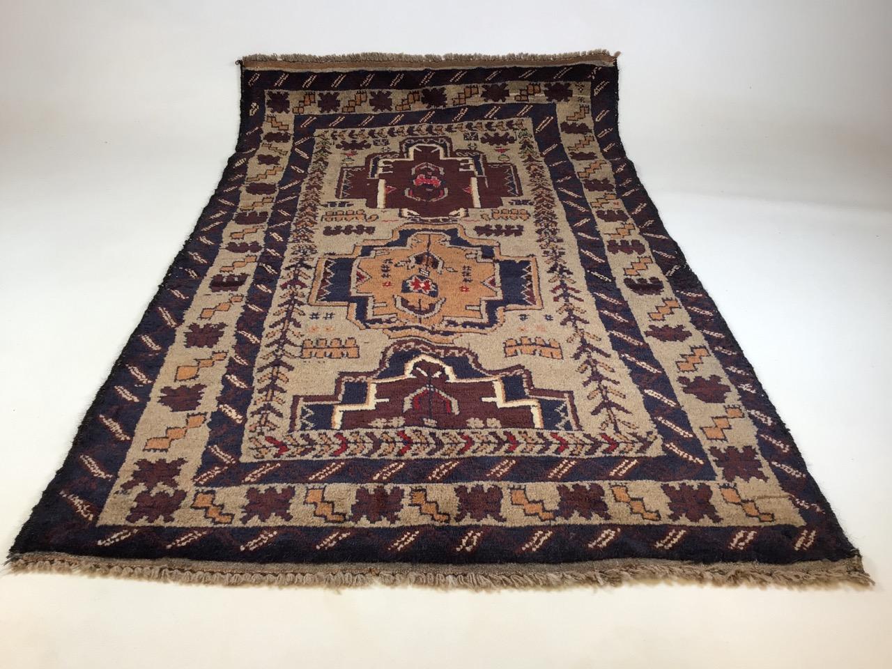 A old Baluchi rug. W:83cm x H:138cm