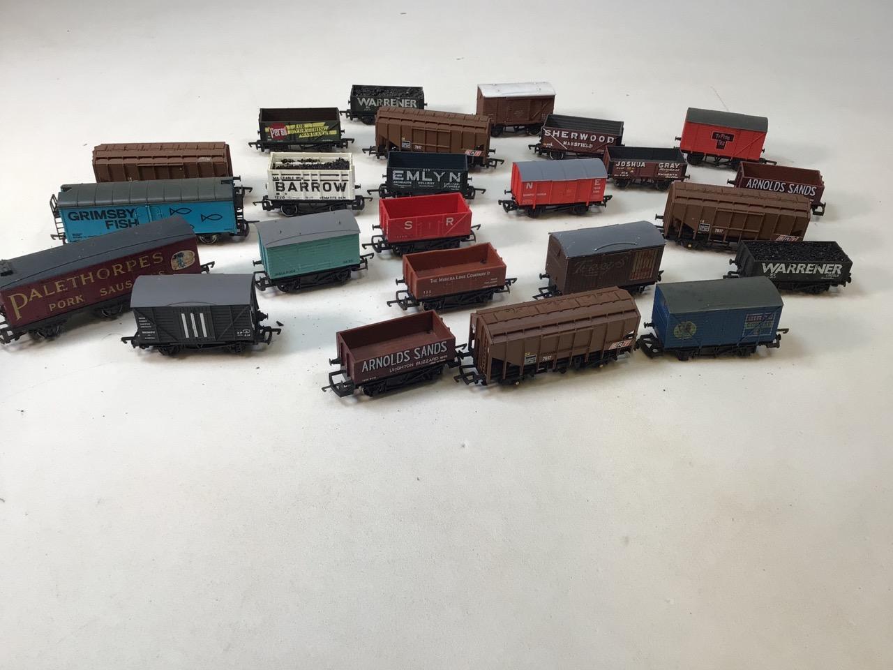 A collection of twenty four 00 gauge railway wagons
