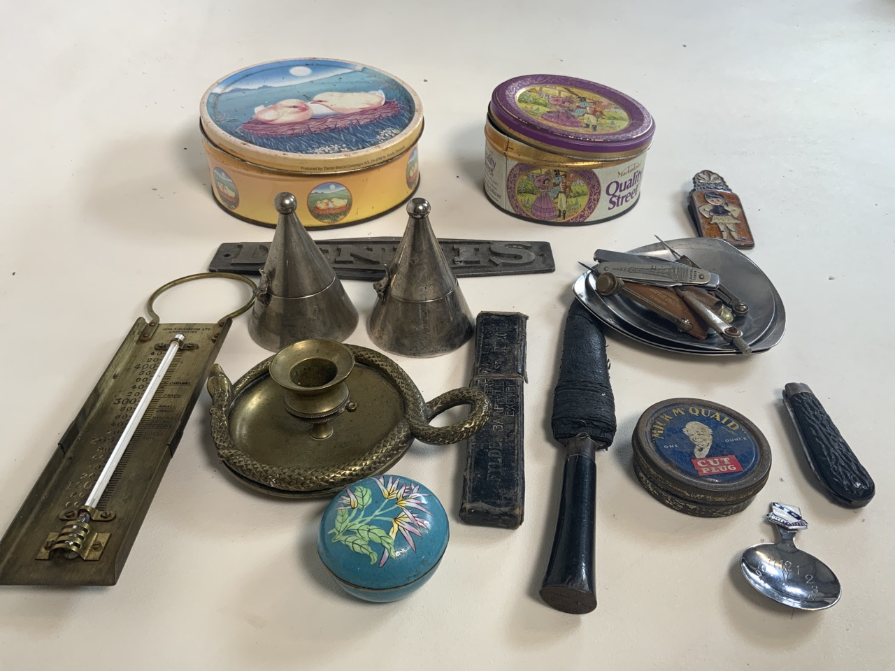 A collection of metalware including two nightlight holders with covers, a brass candle stick with