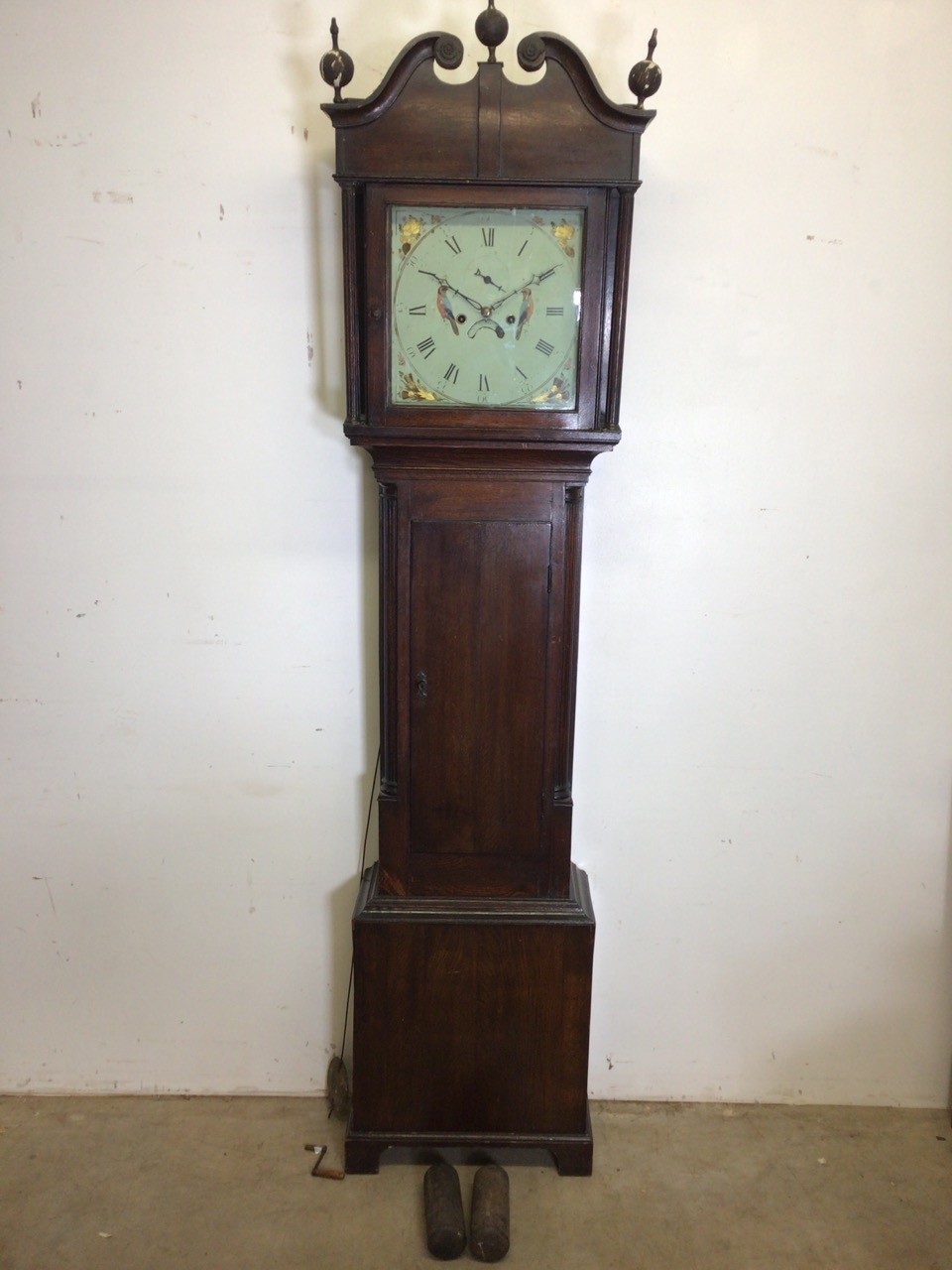An 8 day mahogany longcase clock with weights and pendulum and key with painted face depicting birds