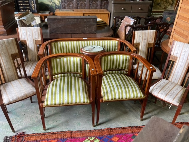A Viennese secessionist mahogany and chequer inlaid parlour suite.