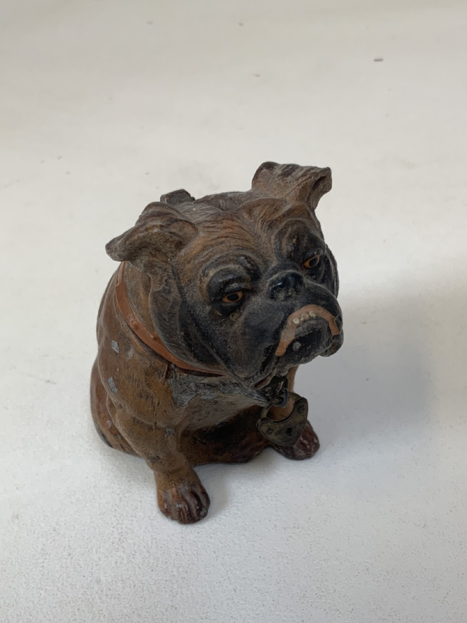Painted metal money box in form of bull dog. 10cm height. Some paint loss