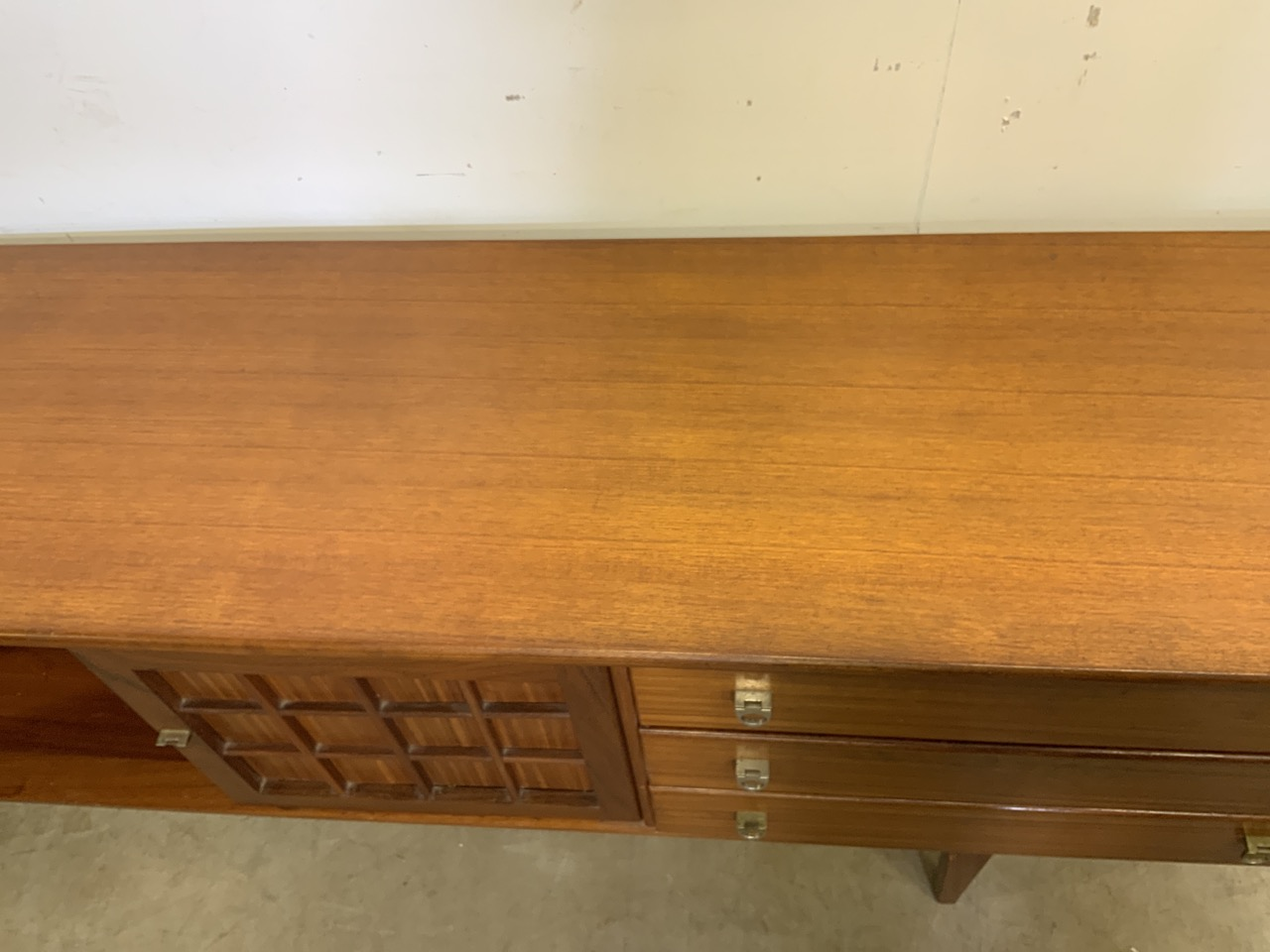 A mid century C.1960s teak sideboard by John Herbert for A Younger. Double cupboard doors to - Image 9 of 10