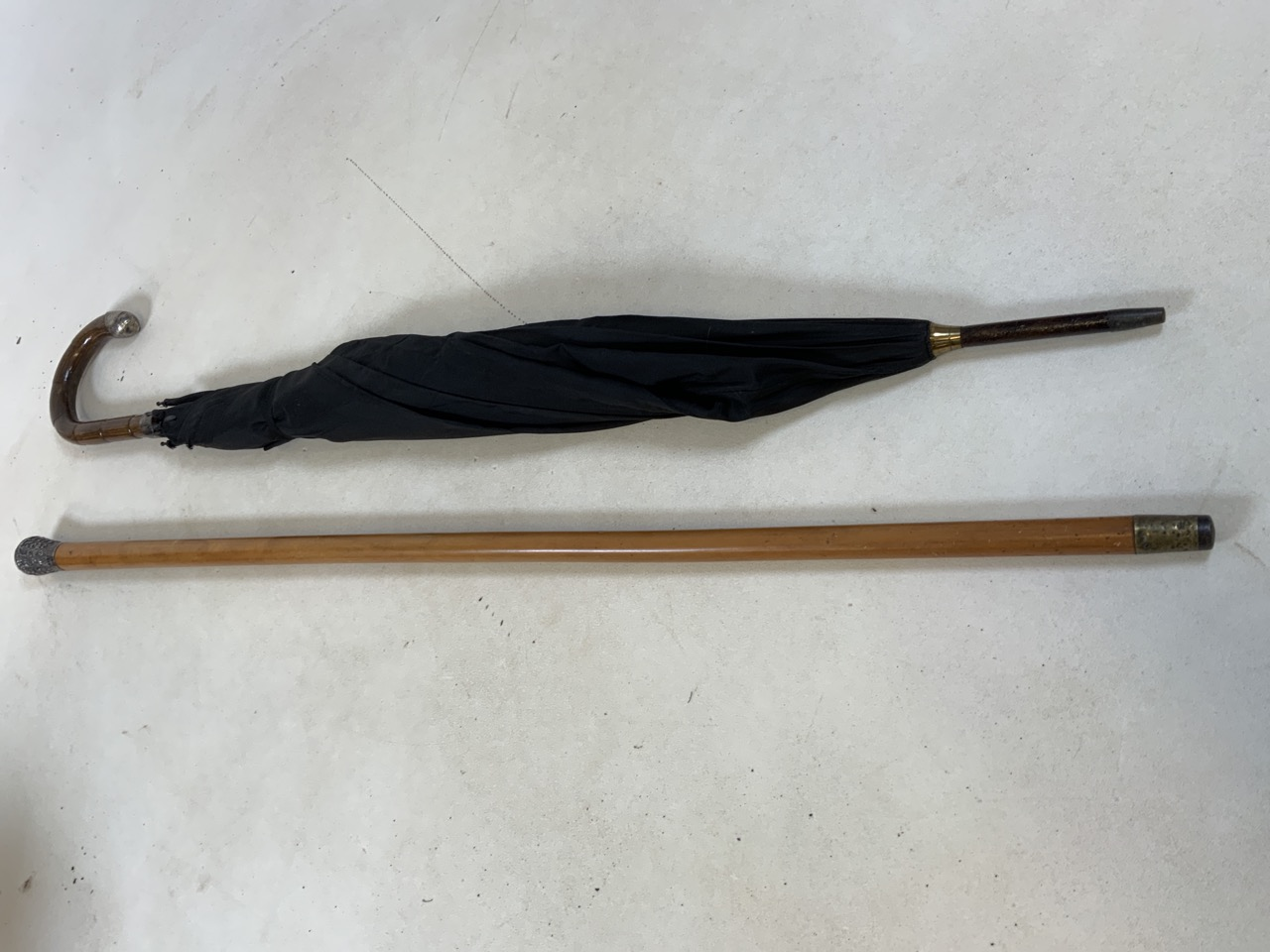 A white metal topped walking cane - decorative top featuring a peacock together with a vintage