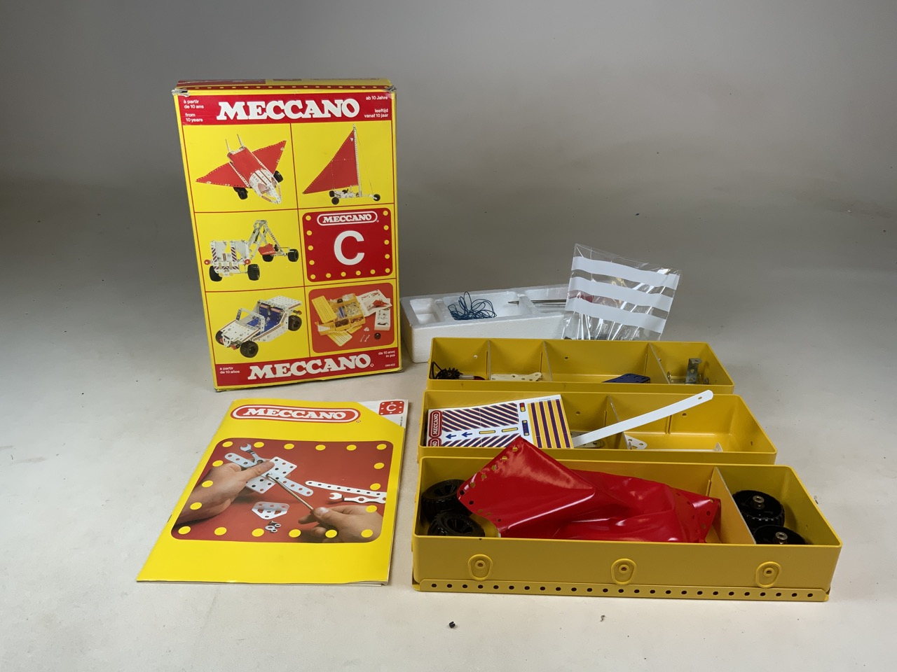 A Meccano C building kit. Three boxes, screws and instruction manuel.