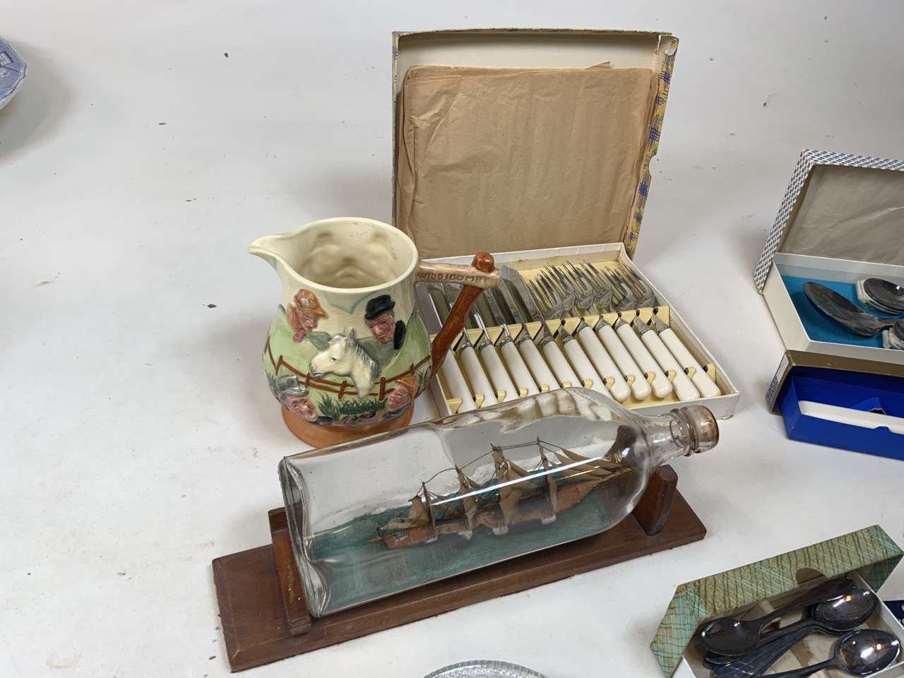 A Japanese ceramic bird cruet together with a copper tea caddy, cutlery, a ship in a bottle , a - Image 2 of 5
