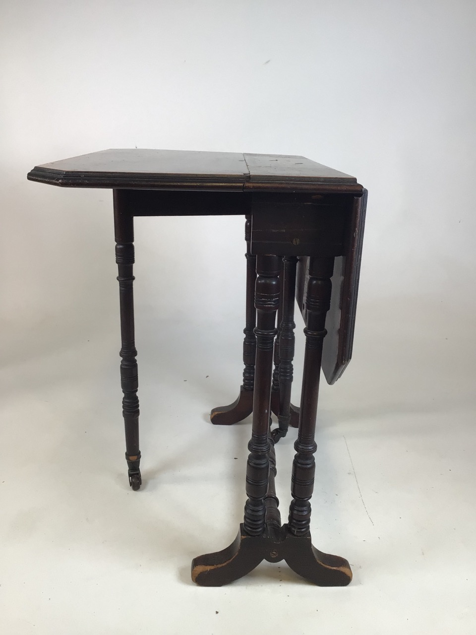 A small Edwardian mahogany inlaid Sutherland table with turned legs and stretcher with ceramic - Image 3 of 9