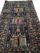 A Baluchi rug on navy ground with multi coloured design featuring three temples. W:104cm x H:197cm