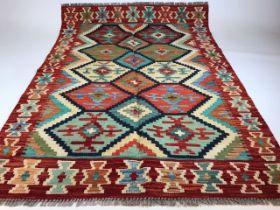 A Chobi Kilim rug. W:103cm x H:148cm