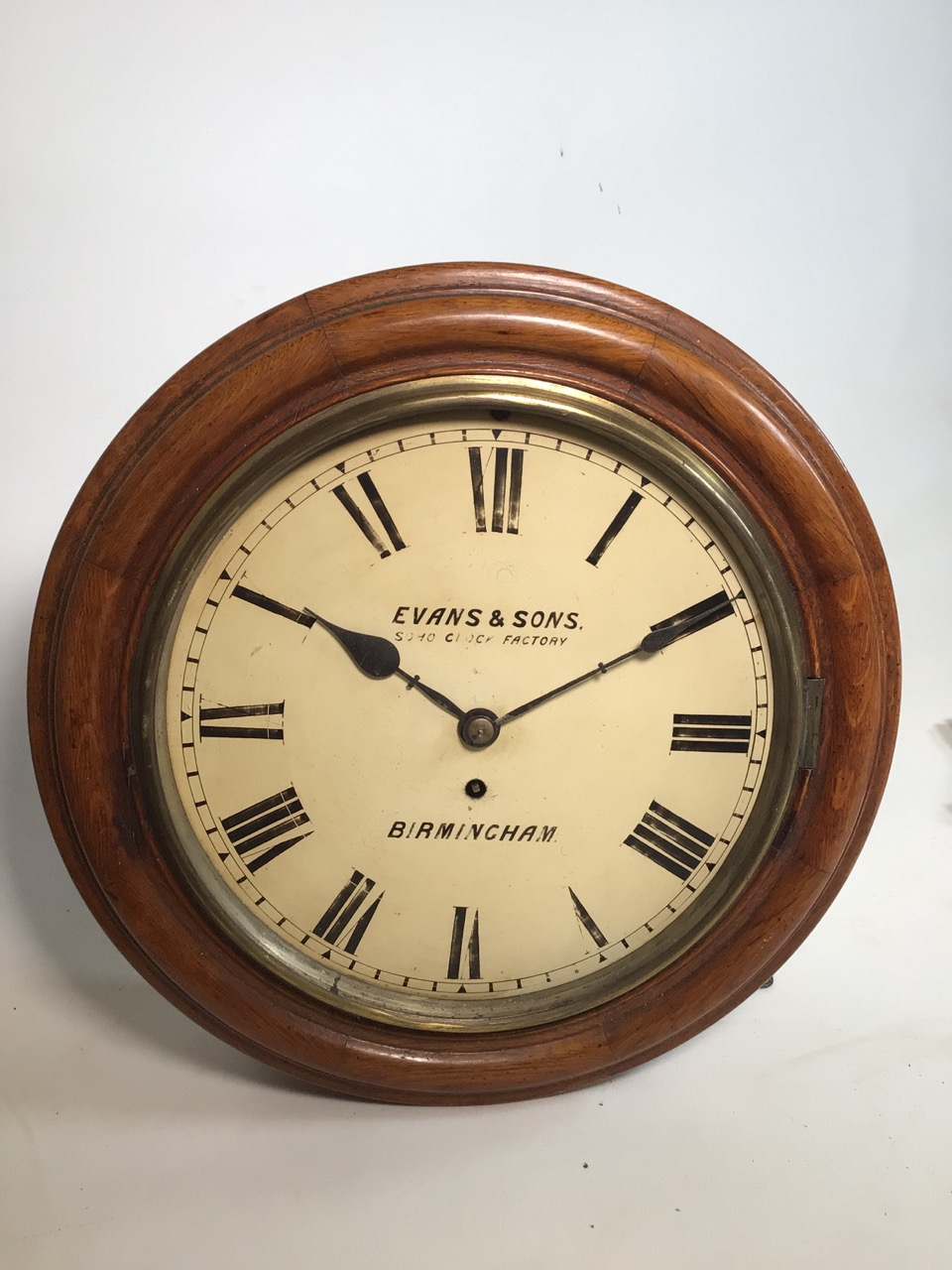 An Evans and sons Birmingham circular Fussee wall clock. Soho clock factory with oak case. Missing
