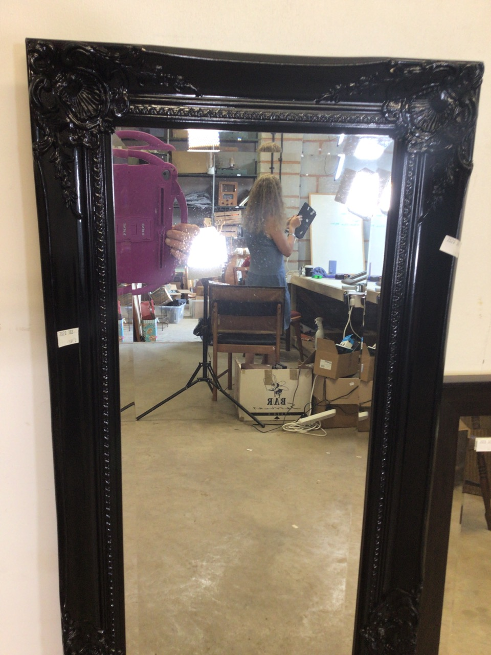 A modern black decorative baroque style mirror with bevelled edge also with another modern mirror. - Image 2 of 4