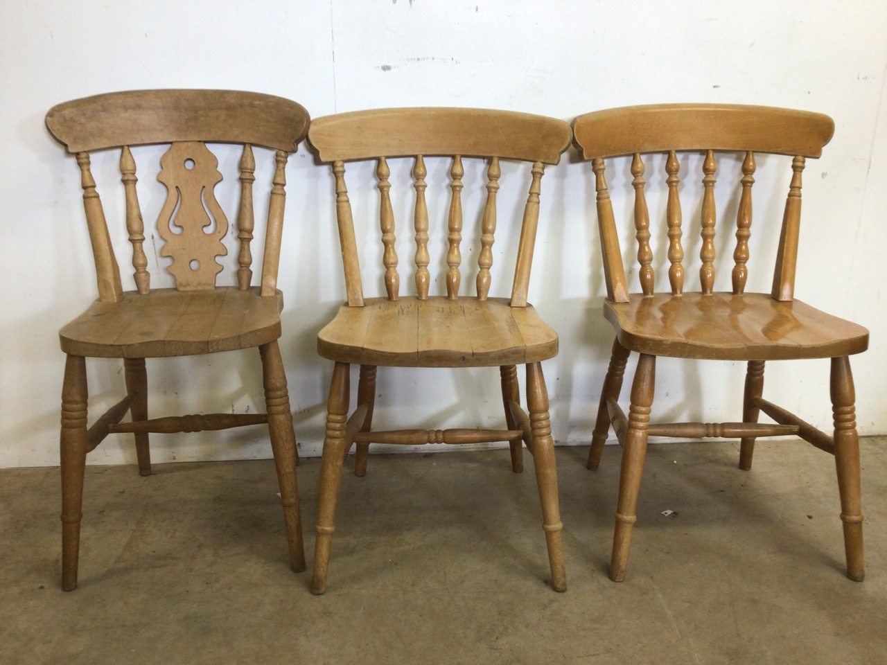 A pair of hardwood kitchen chairs and another. W:44cm x D:43cm x H:84cm