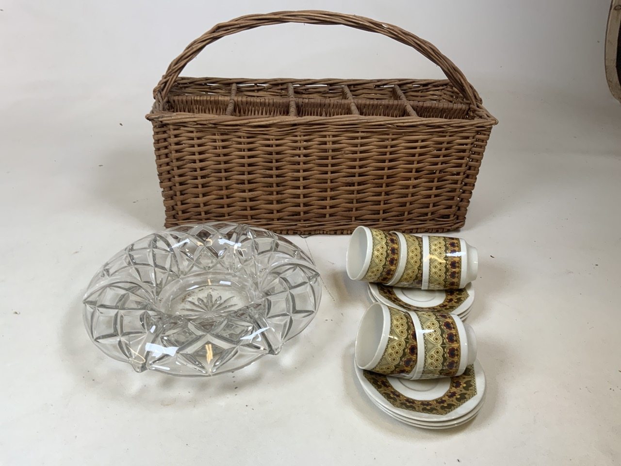 A vintage wicker ten bottle carrier together with Royal Doulton Parquet design tea cups and