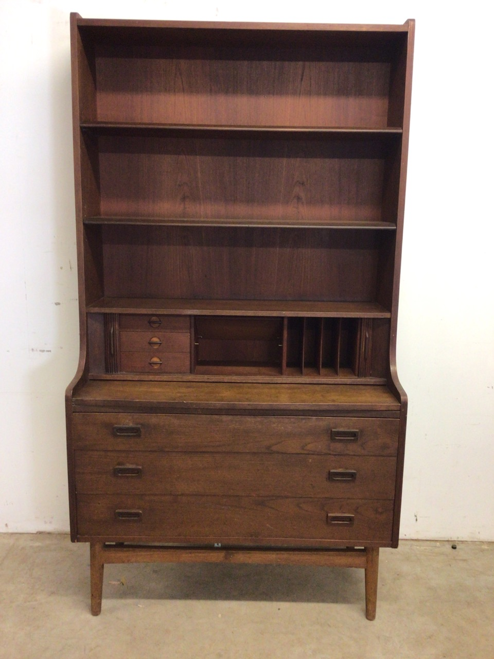 A mid century Danish sideboard with tambour front and three large drawers to base fitted interior.