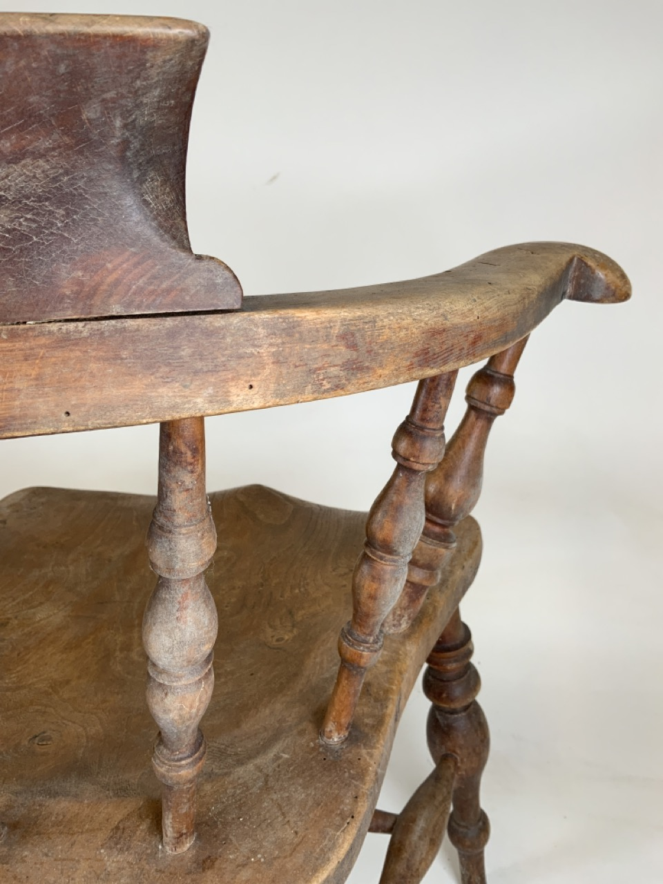 A Victorian smokers bow arm chair with curved top rail and turned spindles with saddle shaped seat - Image 9 of 10