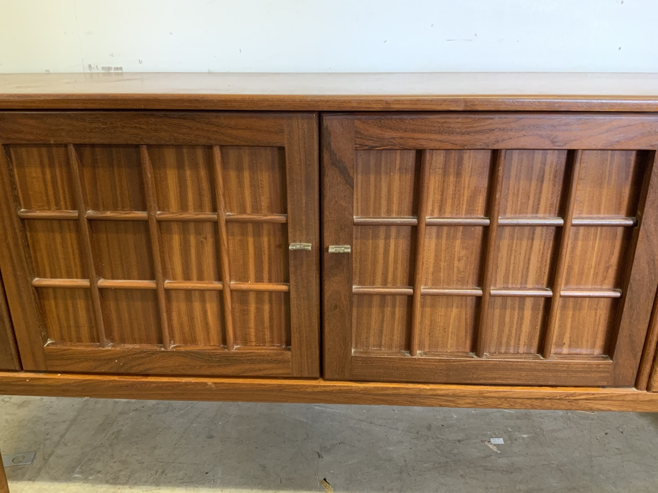 A mid century C.1960s teak sideboard by John Herbert for A Younger. Double cupboard doors to - Image 5 of 10