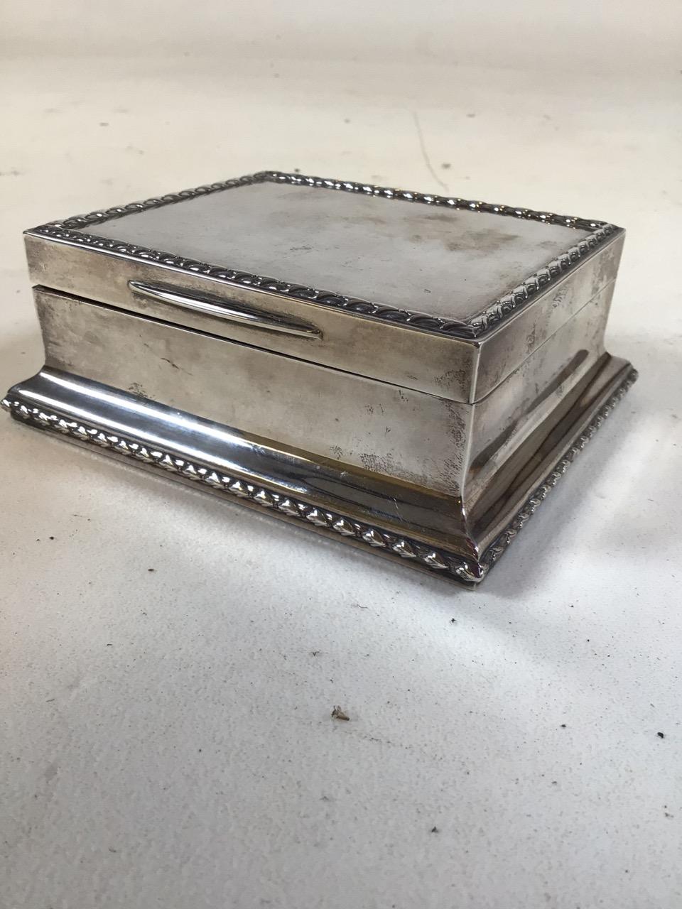 A sterling silver cedar lined cigarette box . by Stuart Dawson & Co London 1913. Gross. 13.8oz. W: