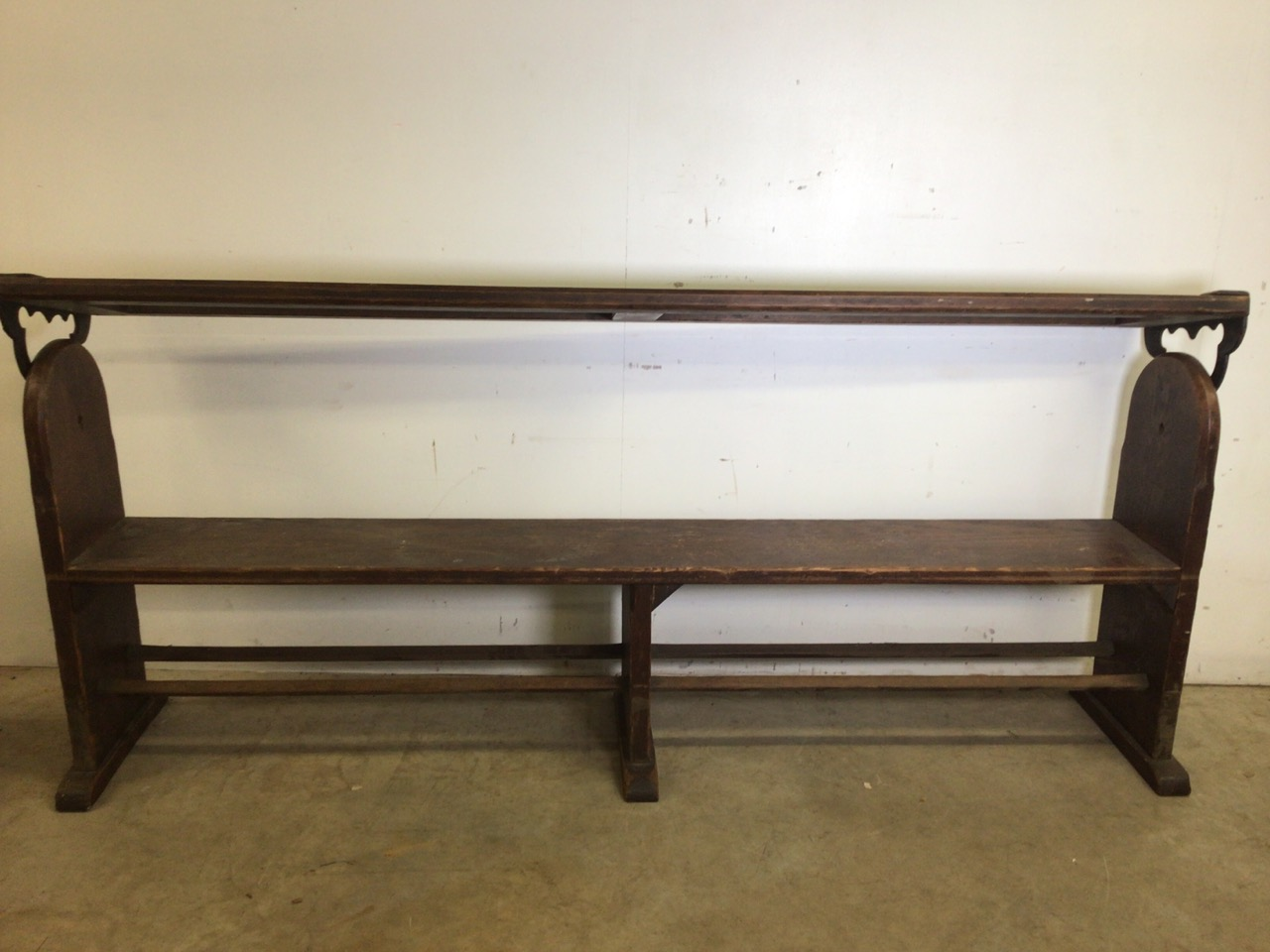 A pitch pine pew with reversable back rest and double footrests. W:215cm x D:50cm x H:82cm - Image 6 of 7