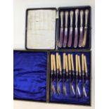 Two boxed sets of Silver handled and silver collared cutlery