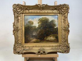 Victorian oil on board river scene in period gilt frame.