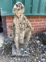 A reconstituted stone statue water feature of a young man. Piped for water. W:40cm x D:24cm x H: