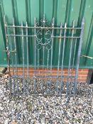A heavy iron gate. W:100cm x H:120cm