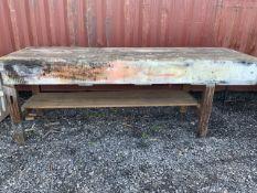 A very long pine work bench. W:261cm x D:78cm x H:94cm