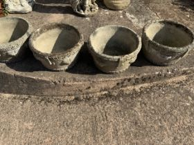 Four circular reconstituted garden pots with geometric designs and grape details. W:45cm x D:45cm