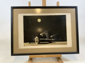 A decorative gangster car print in black frame. W:66cm x H:48cm