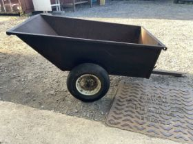 A garden trailer for a lawn mower. By SCG supplies. Slight hole and rust to inside. W:76cm x D:121cm