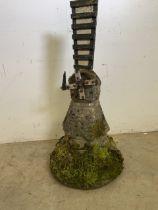 A reconstituted stone statue of a windmill. W:40cm x D:40cm x H:58cm