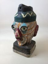 A french vintage painted head with glass eyes - great for the garden
