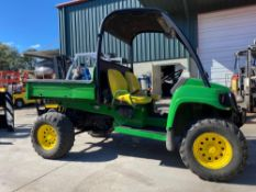 JOHN DEERE GATOR XUV ATV WITH DUMP BED, GAS POWERED, 1,713 HOURS SHOWING, RUNS AND DRIVES