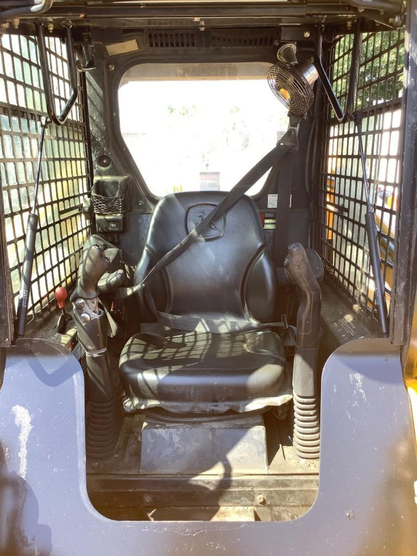 JOHN DEERE SKIDSTEER MODEL 315, DIESEL, GRAPPLE ATTACHMENT, SOLID TIRES, AUX HYDRAULIC, ENCLOSED CAB - Image 11 of 15