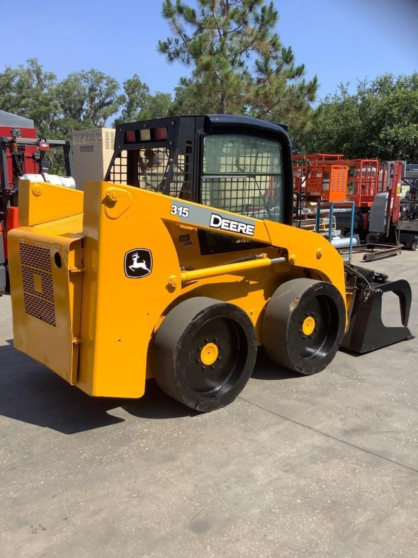 JOHN DEERE SKIDSTEER MODEL 315, DIESEL, GRAPPLE ATTACHMENT, SOLID TIRES, AUX HYDRAULIC, ENCLOSED CAB - Image 4 of 15