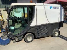MADVAC COMPACT SWEEPER MODEL LS100 ,ENCLOSED CAB,BACK UP CAMERA, A/C AIR, EXTRA KEY