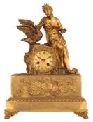A Restauration style mantle clock, with on top Leda and the swan, H 49 - W 35,5 cm