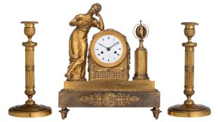 A French Charles X style mantle clock, and a ditto pair of period candlesticks, H 28,5 - 34 cm