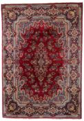 A large Oriental woollen rug, floral decorated, signed, 360 x 260 cm