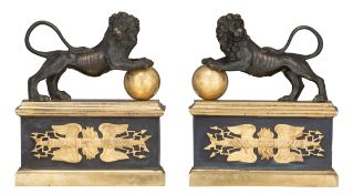 A pair Charles X andirons, crowned with lions, H 24 cm - W 21 cm