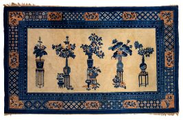 A Chinese rug, decorated with flower vases, 170 x 274 cm