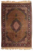 An Oriental Tabriz rug, 284 x 200 cm