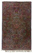 An Oriental Kirman woollen rug, floral decorated, 151 x 244 cm