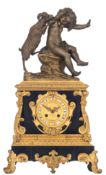 A Napoleon III mantle clock with on top Baccanic scene, H 52 - W 30 cm