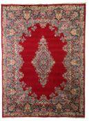 An Oriental Kirman rug, 296 x 395 cm