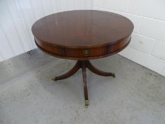 Drum Table - a 20 th C mahogany 4 drawer ( each 11 1/3? wide) with reeded 4 spoked base and brass