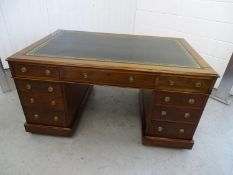 Georgian Partners Desk - a circa 1800 Mahogany pedestal desk with gold tooled single green leather