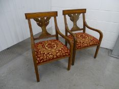 A pair of Walnut Continental open armchairs -two cloth covered overstuffed walnut (20 th C)chairs