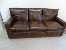 Club Sofa and Armchair- a dark brown leather upholstered 3 seat sofa and single armchair with stud