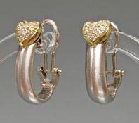 Paar Ohrclipse/-Stecker, 'Herz', WG/GG 750, 20 Brillanten zus. ca. 0.34 ct., etwa cr/vvs, 7.9 g